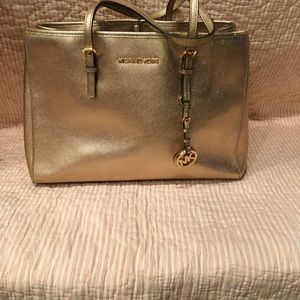 Michael Kors gold handbag